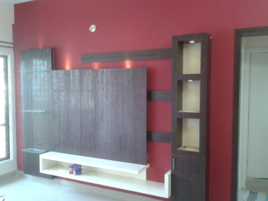 Make a power statement with bold chili red walls and green accents with dark wood intallments