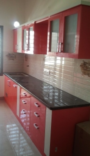 Bright red and white touches add colour to any space big or small