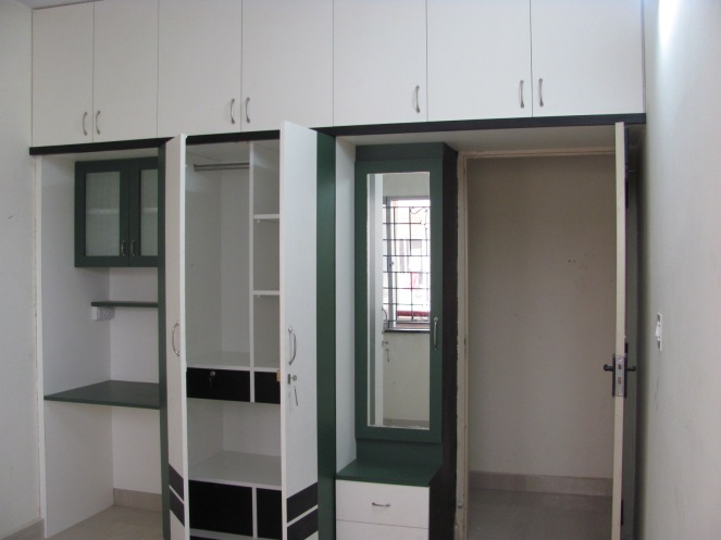 Bottle green and white, this is a built in unit which has a dresser, cuboard and work space