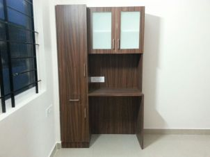 Making use of the corner space with this single storage unit combined with a work station