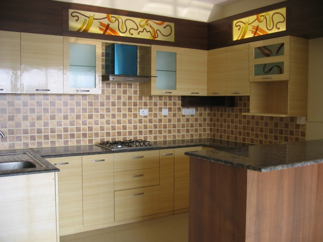 An open kitchen space, with added frosted glass and checkered tiling