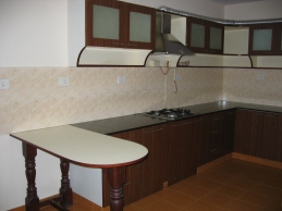 Colour coordinated kitchen and counter with embossed tiles